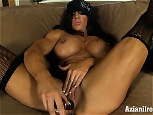 Muscle bound milf uses her glass faux-cock till she spunks