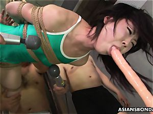 asian strapped up to be sexually tantalized by some deviants