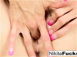 Nikita Von James inserts a toy inside her moist coochie