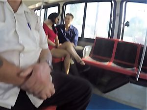 Karmen Bella pokes her dude on a crowded bus