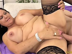 old brown-haired Takes a dick in Her jaws and puss