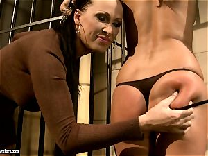 Mandy Bright fettered a molten stunner at the prison steel